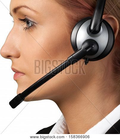 Portrait of a Female Phone Operator in Headset, Side View