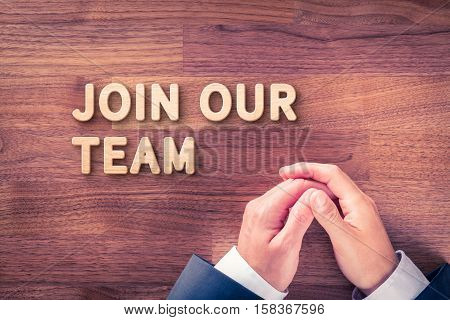 Join our team concept. Headhunter (recruiter) with text join our team - human resources concept.