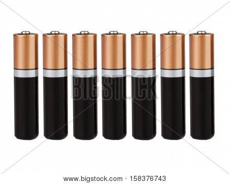 Seven batteries of the type AA in a single row on a white background, isolated
