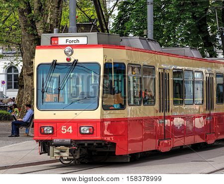 Zurich, Switzerland - 25 May, 2016: a Forch railway train at the stop at Stadelhoferplatz square. The Forch railway (German: Forchbahn or FB) is a local railway line in the Swiss canton of Zurich, owned and operated by the Forchbahn AG company.