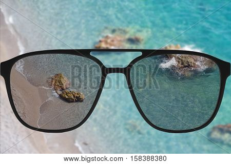 Clear image in sun glasses against blurry land sunny andscape