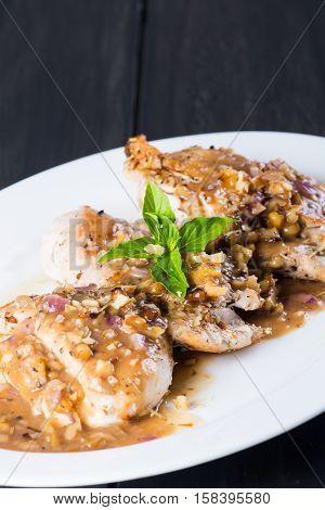 pan fried chicken breast in walnut sweet sauce