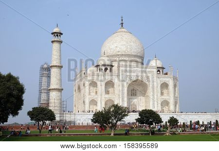 AGRA, INDIA - FEBRUARY 14 : Taj Mahal (Crown of Palaces), an ivory-white marble mausoleum on the south bank of the Yamuna river in Agra, Uttar Pradesh, India on February, 14, 2016.