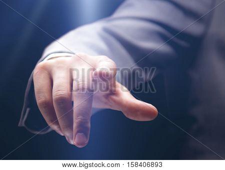 Businessman pressing an imaginary button