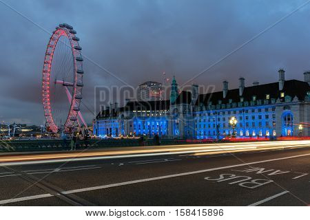 LONDON, ENGLAND - JUNE 16 2016: Night photo of The London Eye and County Hall from Westminster bridge, London, England, Great Britain