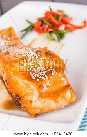 pan fried salmon in a dash of teriyaki sauce