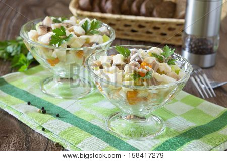 Salad With Marinated Herring, Vegetables And Apple. Appetizer On A Festive Table, Easter Or Birthday