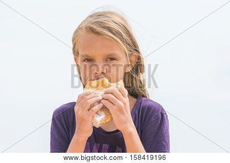 A Hungry Girl With An Appetite Chews Delicious Cake And Looked Into The Frame