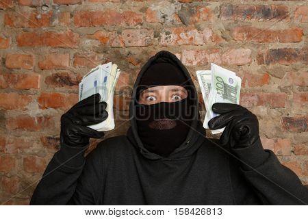 Cracker standing in black gloves