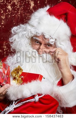 Portrait of Cheerful Santa Claus in Christmas concept  against red  background