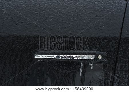 icy grip and a part of the black car door