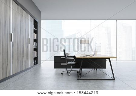 Side View Of A Ceo Office With Wooden Doors And A Bookcase