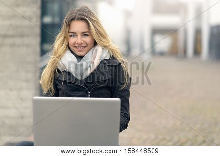 Young Woman Working On Her Laptop