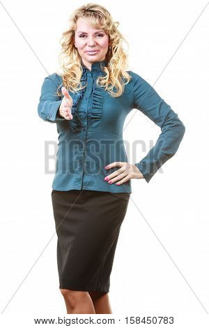 Invitation concept. Elegant middle aged blonde woman welcoming guests. Attractive female reaching out hand isolated on white.