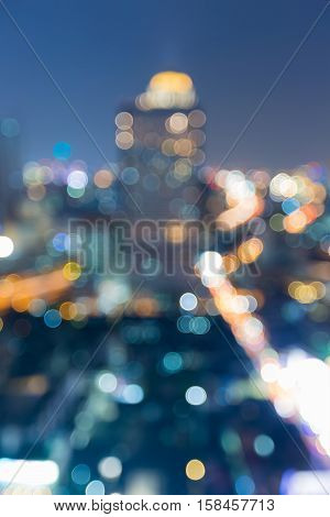 Night blurred light office building tower, abstract background