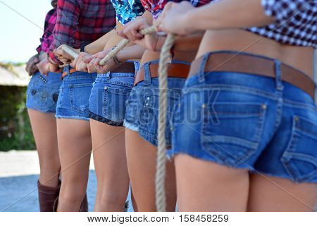 Sexy Back Side of a Cowgirl Wearing Jean Shorts Plaid Shirt