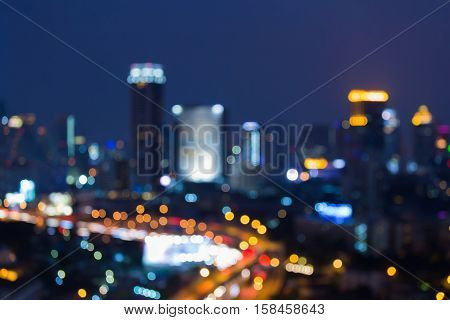 Blurred lights city highway and downtown with twilight sky background