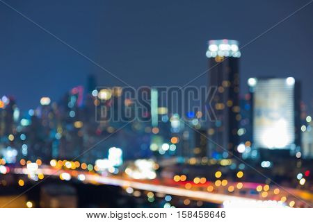 Twilight blurred bokeh light city office building, abstract background