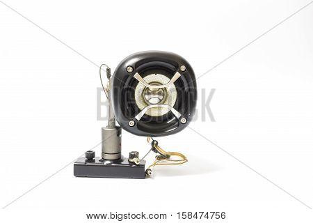 Black old car audio speaker on white background