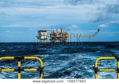il and gas industry and moving cargo from the boat to the platform, boat waiting transfer cargo and crews between oil and gas platform and crews boat operation in boat.