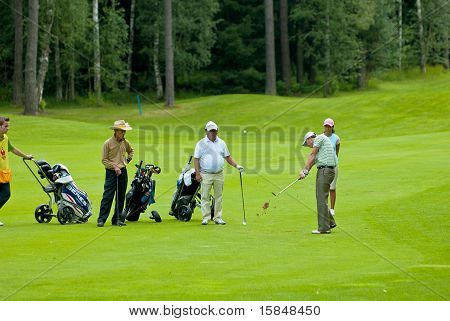 Group unknown golfer on field