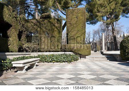 Stone bench in Cecilio Rodriguez Gardens Retiro Park Madrid Spain