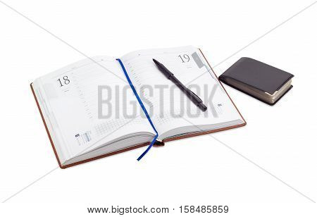 Open business diary with lines for hours in the working day and blue page-marker ribbon and black ballpoint pen on it wallet for business cards on a light background