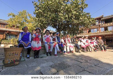 Lijiang, China - November 10, 2016: Old Women Dressed With The Traditional Attire Of Their Minority