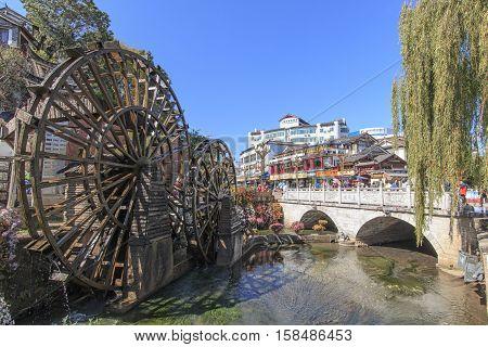 Lijiang China - November 10 2016: Bridge and Water wheels at the entrance on Lijiang Old Town in Yunnan