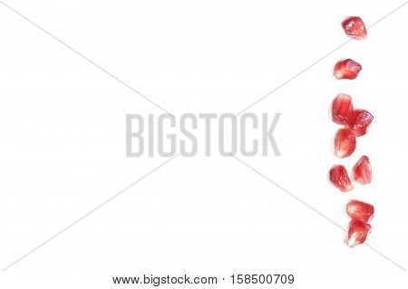 White food background with seeds pomegranate fruit