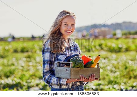 Woman Holding Wooden Crate With Fresh Organic Vegetables