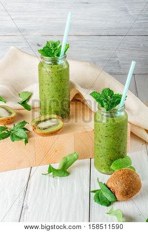 Fruit and vegetable smoothies ingredients for its preparation: kiwi arugula mint