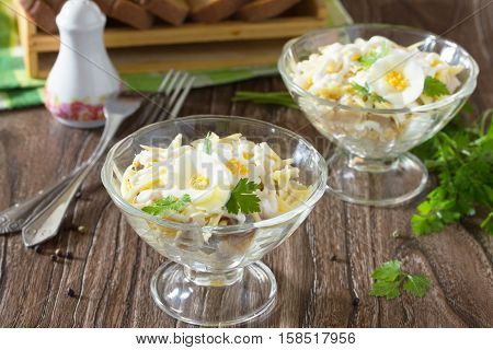 Festive Salad With Pickled Herring, Cheese And Egg. Appetizer On The Table Christmas Or New Year.