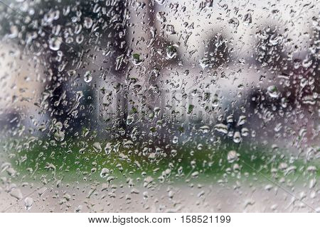 Drops Of Rain On A Window Pane, Blur Buildings In Background.
