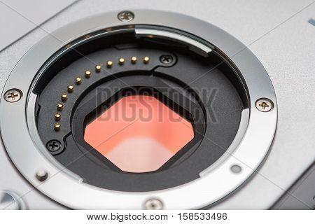 Digital camera sensor. Sensor on a digital mirrorless camera. Glass sensor of digital mirrorless camera and lens mount closeup.