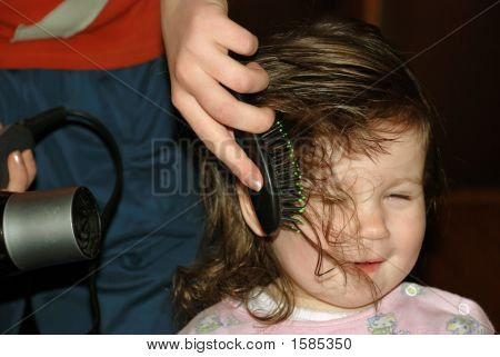 Drying Of Hair By A Hair Drier To The Little Girl