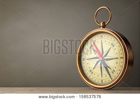 Antique Vintage Brass Compass on a wooden table. 3d Rendering