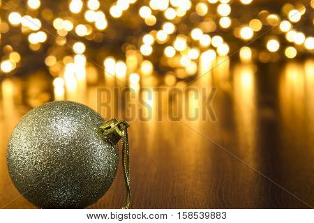 This foto pictured gold Christmas ball and Christmas lights