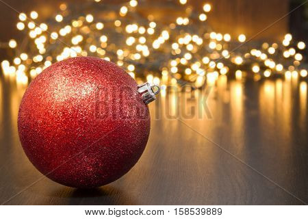 This foto  pictured red Christmas ball and Christmas lights