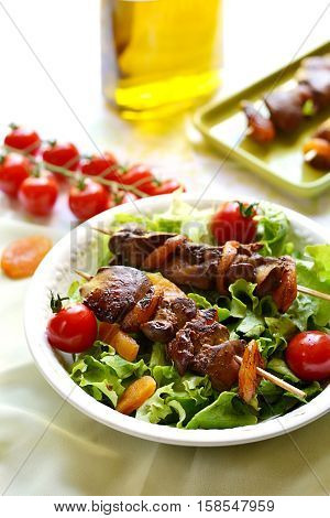 Yakitori with chicken liver dried apricots tomatoes green salad