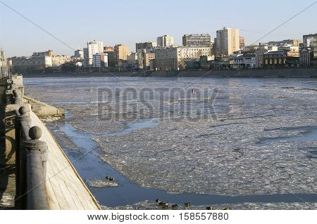View from Berezhkovskaya on Moscow river covered with ice ducks gulls urban landscape