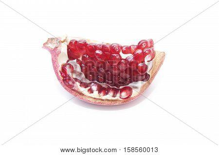 A slice of pomegranate on a white background