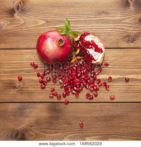Pomegranate On Wooden Background. Top View
