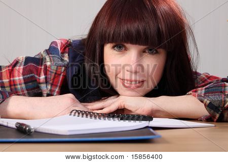 Happy Young Student Girl Takes A Homework Break