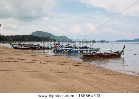 PHUKET THAILAND - 12.11.2016: Fishery boat on the beach of Thai sea in Phuket Thailand