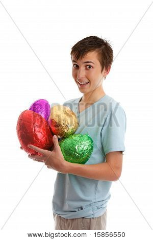 Excited Boy Holding Foil Wrapped Chocolate Easter Eggs