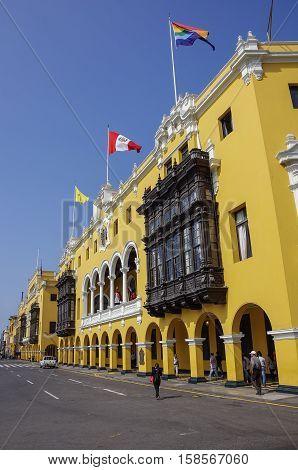 Lima, Peru - December 30, 2013: Municipal building in Plaza Mayor (formerly Plaza de Armas) in Lima Peru in sunny day.