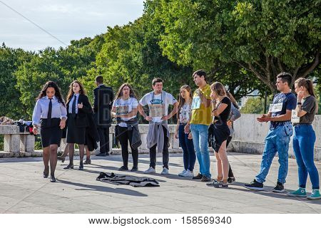 Lisbon, Portugal - October 19, 2016: The Praxe, a ritual initiation where University Freshmen are welcomed by veterans. Controversial practice, where abuse and humiliation are often common.