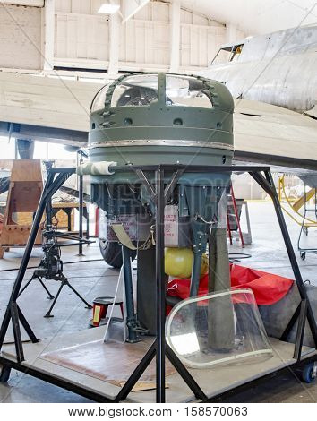 DAYTON, OHIO, USA - NOVEMBER 18, 2016: National Museum USAF is restoring the famous original WWII Memphis Belle B-17F Flying Fortress bomber, shown here the top turret on display in restoration area.