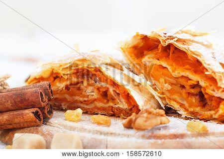 Sweet pumpkin strudel with cinnamon and walnuts. Pumpkin dessert.